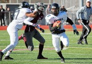 Ansonia quarterback Justin Lopez picks up yards with his feet versus Naugatuck Thanksgiving morning at Naugatuck High School. Ansonia won the game, 46-28. Elio Gugliotti Republican-American