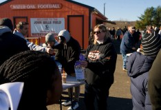 WATERTOWN, CT-112317JS03- Volunteer Cindy Mazzarella, center, solicits donations for the Veterans of Foreign Wars Post 5157 prior to the Watertown-Torrington Thanksgiving Day game Thursday at Watertown High School. The VFW post was broken in to on two occasions last month. Jim Shannon Republican-American