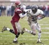 Ansonia's Montrel Dobbs tries to avoid an eventual tackle from Naugatuck's Marquan Williams during Thursday's game at Naugatuck. Josalee Thrift Republican-American
