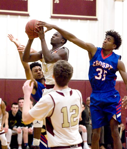Sacred Heart's Raheem Solomon (11) is fouled by Crosby's Ivan Craig (35) while putting up a shot during their game Tuesday at Sacred Heart High School. Jim Shannon Republican-American