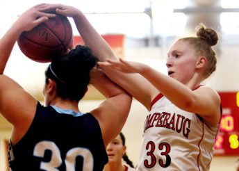 #33 Maggie Lee of Pomperaug High battles for the rebound with #30 Maddie Burce of Wilton during basketball action in Southbury Saturday. Steven Valenti Republican-American