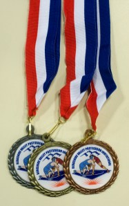 WINSTED, CT-021018JS02-- Metals waiting to be handed out at the Berkshire-Valley Post Season Invitational held Saturday at Northwestern Regional High School. League Jim Shannon Republican-American