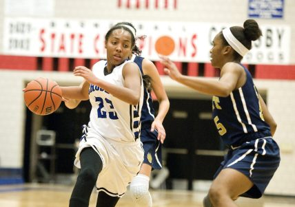 Crosby's Tiahna Pulliam (23) drives to the basket past Platt's Martha Chatman (15) during their Class L opening round game Tuesday at Crosby High School in Waterbury. Jim Shannon Republican-American