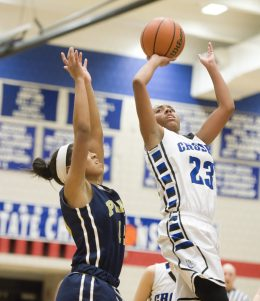 Crosby's Tiahna Pulliam (23) puts up a shot in front of Platt's Madison Chatman (12) during their Class L opening round game Tuesday at Crosby High School in Waterbury. Jim Shannon Republican-American