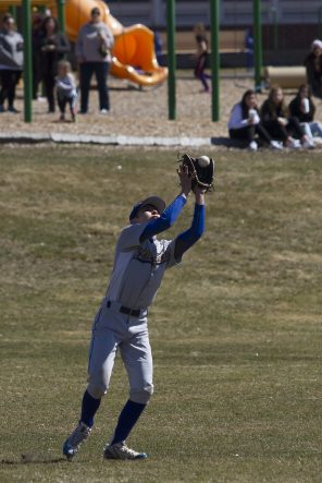 THOMASTON, CT - 31 MARCH - 033118JW09.jpg -- Gilbert outfielder #2 pulls in a ball against Thomaston during Saturdays afternoon 5-3 loss to Thomaston. Jonathan Wilcox Republican-American