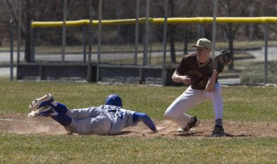 THOMASTON, CT - 31 MARCH - 033118JW11.jpg -- Thomaston #23 Ian Bethin loses the ball at first as Gilbert #23 Kevin Sullivan slides safely back during Thomaston's 5-3 win over Gilbert Saturday afternoon. Jonathan Wilcox Republican-American