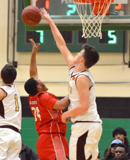 Sacred Heart's Connor Tierney (0) blocks a shot by Wilbur Cross' William Antrum (24) during their Division I quarterfinal game Monday at Wilby High School in Waterbury. Jim Shannon Republican-American