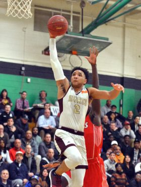Sacred Heart's Isiah Gaiter goes up to slam in two points after stealing the ball during their Division I quarterfinal game against Wilbur Cross Monday at Wilby High School in Waterbury. Jim Shannon Republican-American