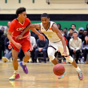 Sacred Heart's Andre Anderson (4) drives past Wilbur Cross' Joel Pullen (2) during their Division I quarterfinal game Monday at Wilby High School in Waterbury. Jim Shannon Republican-American