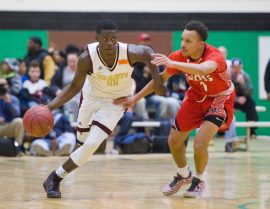 Sacred Heart's Raheem Solomon (11) drives the ball past Wilbur Cross' Joel Pullen (2) during their Division I quarterfinal game Monday at Wilby High School in Waterbury. Jim Shannon Republican-American