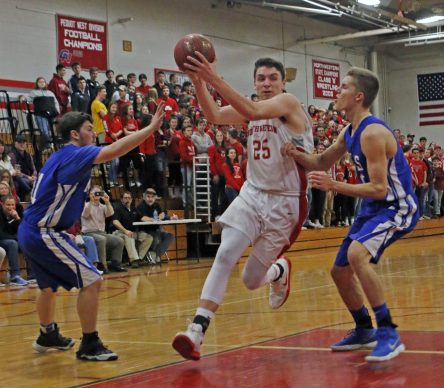 Northwestern Regional's Zack Penn ( 25 ) drives to the hoop as Lewis Mills' Josh Schibi ( 40 ) and Cameron Baiardi (11) defend during the Division IV state tournament quarterfinals Monday night at Northwestern Regional High School. Northwestern defeated Lewis Mills 58 -35 Michael Kabelka / Republican-American