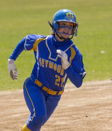 WATERBURY, CT-042118JS09- ACTION PERSON- Seymour's Morgan Teodosio (21) make her way home to score on her second home run on the day during their game against Holy Cross Saturday at Holy Cross High School. Jim Shannon Republican American