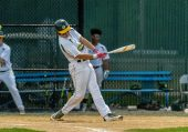 WATERBURY, CT. 25 May 2018-052518BS05 - Holy Cross's Corey Fappiano (4) gets a key hit knocking in two runs to tie the game during the NVL Championship game between St Paul Catholic and Holy Cross at Municipal Stadium on Friday afternoon. Holy Cross came back to win 6-5. Bill Shettle Republican-American