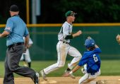 WATERBURY, CT. 25 May 2018-052518BS05 - Holy Cross's Will Greene (3) steps on second base in front of St Paul's Sean Crean (6), ending the inning during the NVL Championship game between St Paul Catholic and Holy Cross at Municipal Stadium on Friday afternoon. Holy Cross came back to win 6-5. Bill Shettle Republican-American