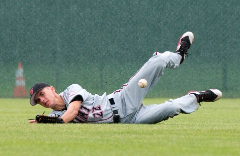 Foutch's Matthew Yambrick (22) tried to make a diving catch in the outfield during their Mickey Mantle World Series game against South Troy Wednesday at Municipal Stadium in Waterbury. Jim Shannon Republican American