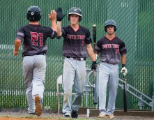 South Troy's Carmen Erno (21) is congratulated by teammates Avery Pascucci (2) and Christian Knodo (18) after coming in to score during their Mickey Mantle World Series game against Foutch of Flint Township (MI) Wednesday at Municipal Stadium in Waterbury. Jim Shannon Republican American
