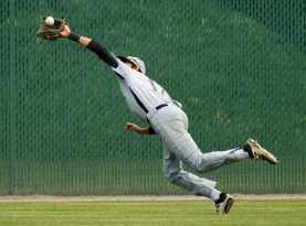 Colton's Elias Rios (17) makes a diving catch in center field during their Mickey Mantle World Series game against Ontario Saturday at Municipal Stadium in Waterbury. Jim Shannon Republican-American