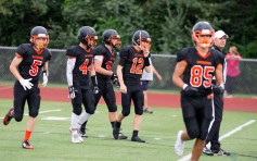 Watertown players head to the line of scrimmage during their pre-season scrimmage against New London Friday at Watertown High School, Jim Shannon Republican American