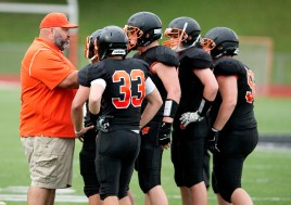 Watertown head coach Luigi Velardi talks with his team during a break in the action of their pre-season scrimmage against New London Friday at Watertown High School. Jim Shannon Republican American