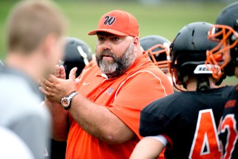 Watertown head coach Luigi Velardi gets his team pumped up after a time out during their pre-season scrimmage against New London Friday at Watertown High School. Jim Shannon Republican American