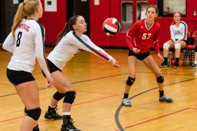 Abby Romano of Pomperaug hits the ball as teammates Autumn Ciccarella #8 and Jenny Meyer #57 look on as Pomperaug hosts Seymour in a girls volleyball scrimmage at Pomperaug High School in Southbury on Monday afternoon. Bill Shettle Republican-American