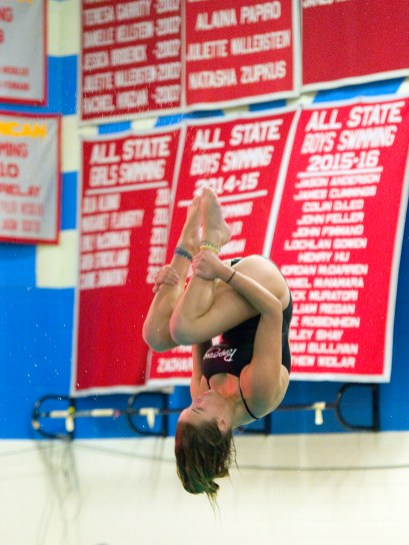 Pomperaug's Jane Schnyder performs her dive during thier meet against Stratford in SWC swim action Tuesday at Pomperaug High School. Jim Shannon Republican American