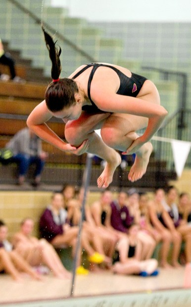 Sacred Heart's Haley Tucker completes her dive during their meet with Seymour Wednesday at Kennedy High School in Waterbury. Jim Shannon Republican American