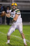 Holy Cross Corey Fappiano (4) stands in the pocket during their game against Ansonia Friday at Nolan Field in Ansonia. Jim Shannon Republican American