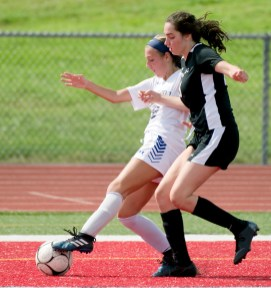 Bunnell's Rachel Ciuci (10) and Pomperaug's Jayde Zainc (18) run down a loose ball in the corner during their game Saturday at Pomperaug High School. Jim Shannon Republican American