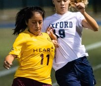 Sacred Heart's Janet Lliguizaca #11 battles for control of the ball with Oxford's Abby Remond #19, during the NVL Girls Soccer Game between Oxford and Sacred Heart at Municipal Stadium in Waterbury on Wednesday. Bill Shettle Republican-American