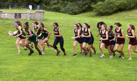 Runners from Holy Cross, Torrington, Kennedy and Wilby take to the course during their meet Wednesday at Holy Cross High School in Waterbury. Jim Shannon Republican American