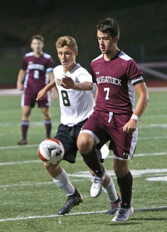 Naugatuck High School's Tommy Martins battles Woodland High School's Cole Barros for the ball during the boys varsity soccer game in Naugatuck on Thursday. Emily J. Reynolds. Republican-American