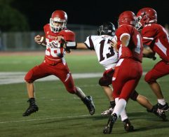 Wolcott High School's Ian Helbig tries to avoid the tackle by Torrington High School's Joey Zepperi during the varsity football game in Wolcott on Friday. Emily J. Reynolds. Republican-American