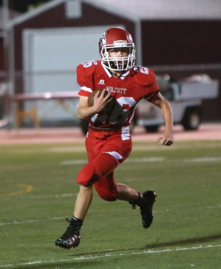 Wolcott High School's Ian Helbig runs the ball up the field during the varsity football game in Wolcott against Torrington High School on Friday. Emily J. Reynolds. Republican-American