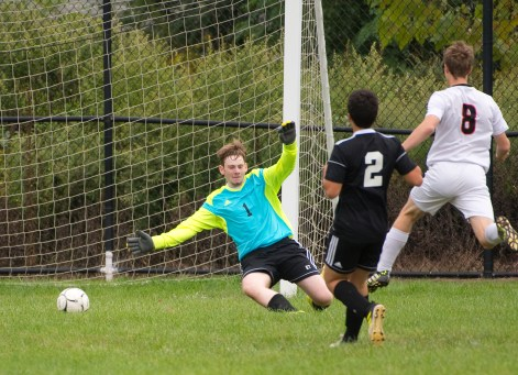 Goodwin Tech's Jordan Gillis (8) fires a goal past Kaynor Tech goalkeeper Connor Cappoziello after getting past Kaynor's Gustavo Silva (2) during their game Monday at Kaynor Tech High School in Waterbury. Jim Shannon Republican American