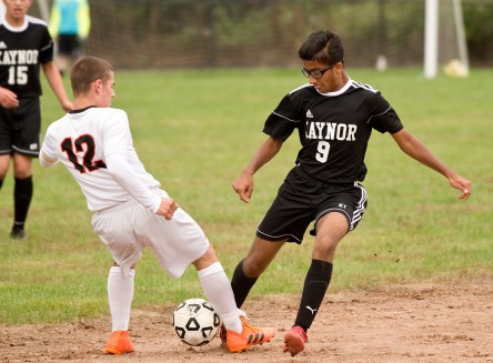 Kaynor Tech's Zachary Persaud (9) has the ball stolen as she tries to slips past Goodwin Tech's Hunter Holley (12) during their game Monday at Kaynor Tech High School in Waterbury. Jim Shannon Republican American
