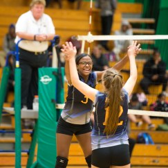 Kennedy's Krystal Matos (3) and Test Tili (12) celebrate a point during their NVL volleyball game against Wilby Tuesday at Wilby High School in Waterbury. Jim Shannon Republican American