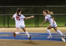 Watertown's Meadow Mancini #10 celebrates with teammate Morgan Dodge #11 after scoring a goal during a NVL Girls Soccer game between Watertown and Holy Cross at Municipal Stadium in Waterbury on Wednesday. Watertown won 2-0, scoring two second half goals. Bill Shettle Republican-American