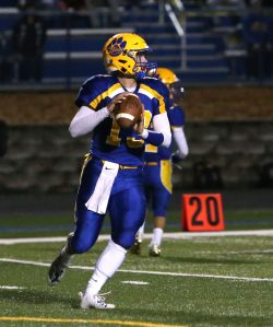 Seymour High School quarterback Ian Sadick looks up the field for an open receiver during the varsity football game in Seymour against Holy Cross High School on Friday. Emily J. Reynolds. Republican-American