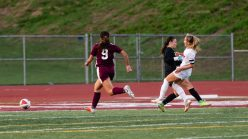 Watertown's Meadow Mancini shoots the ball into the net past Naugatuck's goalkeeper Sydney O'Donnell and Naugatuck's Sophia Marquez #9 during a Girls NVL Soccer game between Watertown and Naugatuck at Naugatuck High School in Naugatuck on Monday. Bill Shettle Republican-American