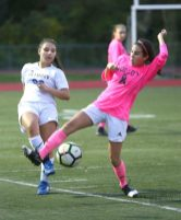 Wolcott High School's Samantha Riviezzo battles Seymour High School's Zana Imetovski for the ball during the girls varsity soccer game in Wolcott on Thursday. Emily J. Reynolds. Republican-American