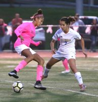 Wolcott High School's Ella Vaughn tries to move the ball up the field around Seymour High School's Suzana Imetovski for the ball during the girls varsity soccer game in Wolcott on Thursday. Emily J. Reynolds. Republican-American