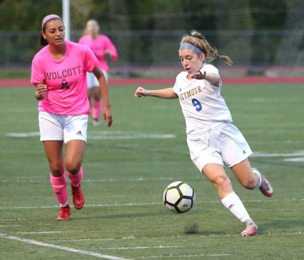 Seymour High School's Amanda Backus moves the ball up the field ahead of Wolcott High School's Alex Arteaga during the girls varsity soccer game in Wolcott on Thursday. Emily J. Reynolds. Republican-American