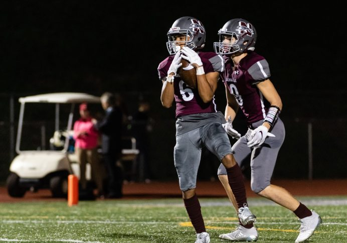 Naugatuck's Elijah Robinson #6 catches the ball before running 80 yards for a touchdown during a NVL Football game Between Oxford and Naugatuck at Naugatuck High School in Naugatuck on Friday. Bill Shettle Republican-American