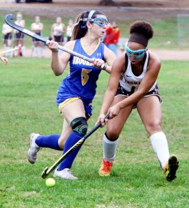 #12 Kaya Johnson of Thomaston and #5 Hannah Grieco of Brookfield battle for the ball during field hockey action in Thomaston Monday. Steven Valenti Republican-American