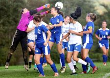 Goal Keeper Sydney Donohue of Litchfield tries to block a shot as #15 Dani Forte of Nonnewaug scores a goal during soccer action in Litchfield Tuesday. Steven Valenti Republican-American