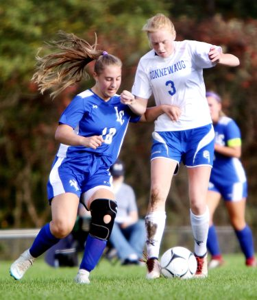 #3 Sofia Pagnament of Nonnewaug tries to keep the ball from #18 Landrie Spelman of Litchfield during soccer action in Litchfield Tuesday. Steven Valenti Republican-American