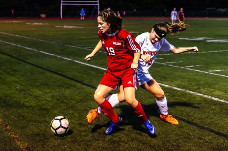 Wolcott's Morgan Matyoka #19 and Watertown's Emma Geise #15 battle for the ball along the sideline during a Girls NVL Soccer game between Watertown and Wolcott at Wolcott High School in Wolcott on Wednesday. Bill Shettle Republican-American
