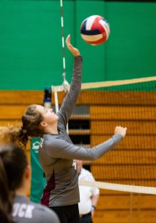 Naugatuck's Hailey Russell #4 hits the ball over the net during a NVL Volleyball match between Naugatuck and Wilby at Wilby High School in Waterbury on Thursday. Bill Shettle Republican-American