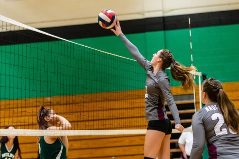 Naugatuck's Brielle Behuniak #6 tips the ball over the net during a NVL Volleyball match between Naugatuck and Wilby at Wilby High School in Waterbury on Thursday. Bill Shettle Republican-American